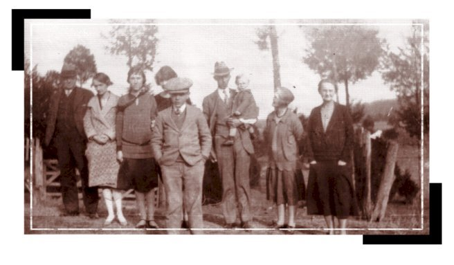 A RUSSELL-SANDERS FAMILY PHOTO:CIRCA 1927 in front of 'My Home In Alabama'